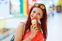 Attractive woman with ice cream Stock Photography