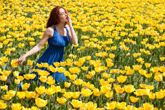 Attractive Woman In Blue Dress In Beautiful Flower Field Royalty Free Stock Photos