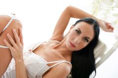 Free Attractive Woman In Sexy White Lingerie Lying In The Seductive Pose Stock Images - 168706104
