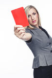 Attractive woman issuing a red card Royalty Free Stock Photos