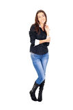 Attractive woman in jeans dreamily looking up Stock Photo