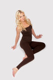 Attractive woman in a jogging suit Stock Photos