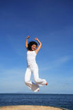 Attractive Woman Jumping Royalty Free Stock Images
