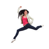 Attractive woman jumping. Smiling woman split jumping with arm raised. Full length studio shot isolated on white Stock Image