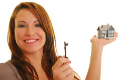 Attractive woman with key and miniature house Stock Images