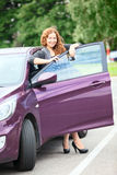 Attractive woman with keys standing near car Royalty Free Stock Photos