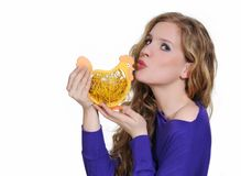 Attractive woman kissing Easter chicken Stock Image