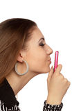 Attractive woman kissing her mobile phone Stock Photography