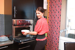 Attractive woman in kitchen royalty free stock photography