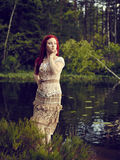 Attractive woman on the lake Royalty Free Stock Images