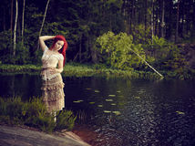 Attractive woman on the lake Royalty Free Stock Image