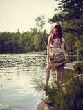Attractive woman on the lake Royalty Free Stock Photos