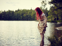 Attractive woman on the lake Royalty Free Stock Photography