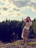 Attractive woman on the lake Stock Image