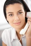 Attractive woman with landline phone Stock Photography