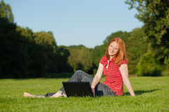 An attractive woman with laptop Royalty Free Stock Photography