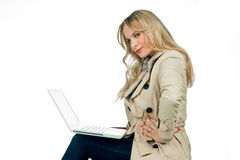 Attractive woman with laptop Stock Images