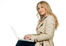 Attractive woman with laptop Royalty Free Stock Photography