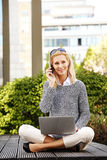 Attractive woman with laptop and handy Royalty Free Stock Photography