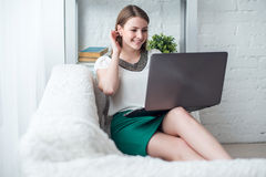 Attractive woman with laptop having break in Royalty Free Stock Photography