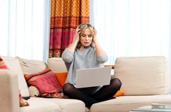 Attractive woman with laptop and headache Royalty Free Stock Photo