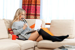 Attractive woman with laptop in home Stock Photography