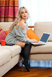 Attractive woman with laptop in home Royalty Free Stock Image