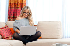Attractive woman with laptop in home Stock Images