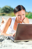 Attractive woman with laptop Stock Image