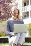 Attractive woman with laptop Royalty Free Stock Photo