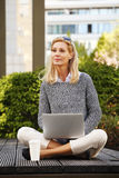 Attractive woman with laptop Stock Photography