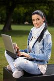 Attractive woman with laptop and sandwitch Stock Images