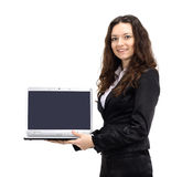 Attractive woman with a laptop turned toward the screen in the hands smiling Stock Photography