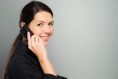 Attractive woman laughing on her mobile phone Royalty Free Stock Photos