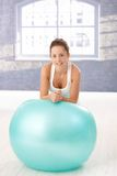 Attractive woman leaning on fitball after workout Royalty Free Stock Photo