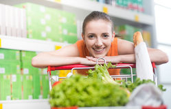 Attractive woman leaning on trolley Royalty Free Stock Photography
