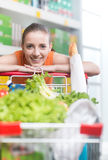 Attractive woman leaning on trolley Royalty Free Stock Photo