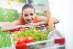 Attractive woman leaning on trolley Royalty Free Stock Image