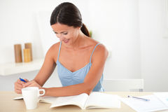Attractive woman learning by reading a book Stock Image