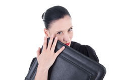 Attractive woman with leather case Stock Images