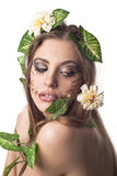 Attractive woman with leaves in her hair Stock Photos