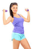 Attractive woman lifting dumbbells Stock Image