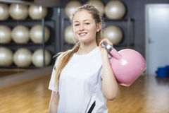 Attractive Woman Lifting Kettlebell In Gym Royalty Free Stock Photography