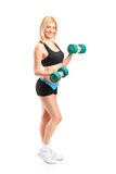 Attractive woman lifting up weights Royalty Free Stock Photography