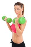 Attractive woman lifting weights Royalty Free Stock Photo