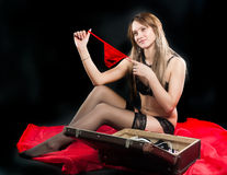Attractive woman in lingerie with suitcase Royalty Free Stock Photography