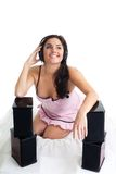 Attractive woman listen music Stock Images
