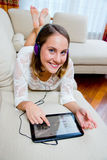Attractive woman listen music on sofa Stock Photos