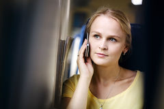 Attractive woman listening to a call on her mobile Royalty Free Stock Photos