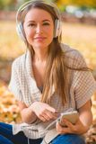 Attractive woman listening to her music library Stock Photo
